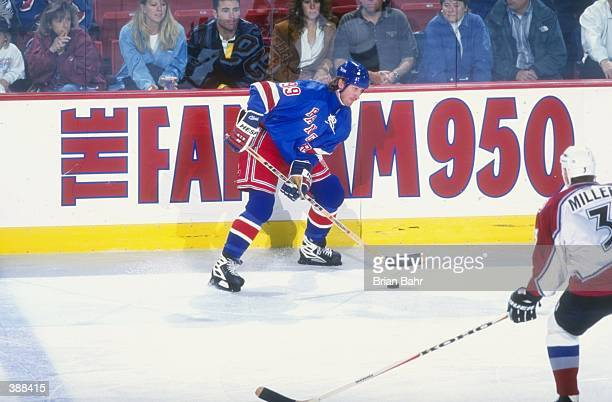 Center Wayne Gretzky of the New York Rangers and defenseman Aaron Miller of the Colorado Avalanache in action during a game at the McNichols Arena in...