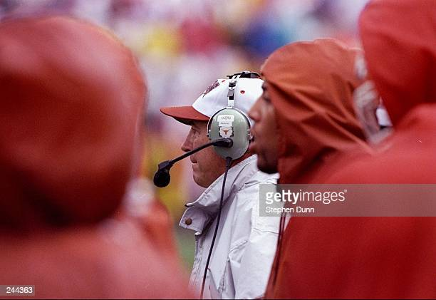 Coach John Mackovic of the Texas Longhorns watches his players during a game against the Texas AM Aggies at Kyle Field in College Station Texas Texas...