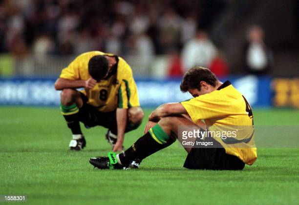 Craig Foster and Steve Hovart of Australia are dejected after being defeated by Iran in the second leg of the World Cup Qualifier between Australia...