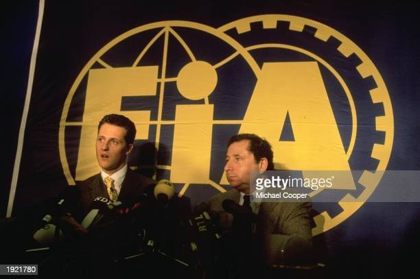 Ferrari driver Michael Schumacher and team director Jean Todt talk to the press after the FIA Disciplinary Meeting at the RAC Headquaters in...