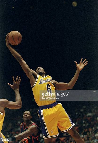 Forward Eddie Jones of the Los Angeles Lakers drives to the basket during a game against the New York Knicks at the Great Western Forum in Inglewood...
