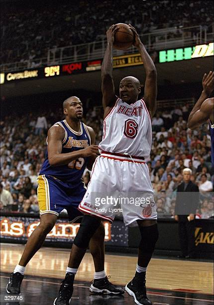 Forward Terry Mills of the Miami Heat in action against center Sean Rooks of the Los Angeles Lakers during a game at the Miami Arena in Miami Florida...