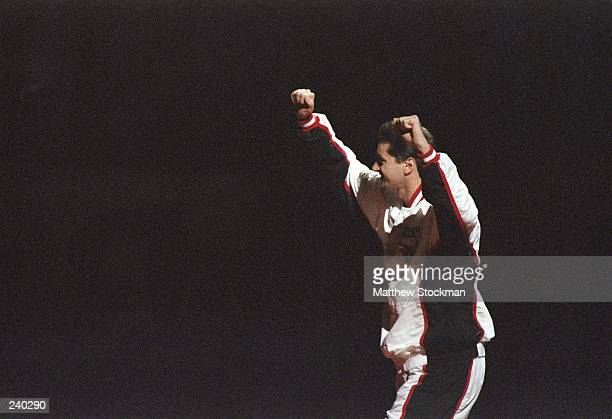 Forward Toni Kukoc of the Chicago Bulls raises his arms into the air during the presentation of championship rings prior to a game against the...
