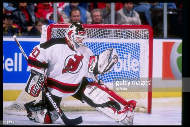 Goaltender Martin Broduer of the New Jersey Devils makes a save during a game against the New York Islanders at the Continental Airlines Arena in...