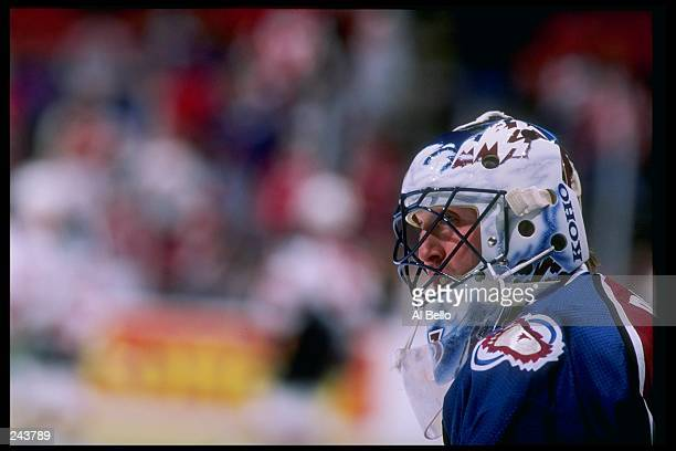 Goaltender Patrick Roy of the Colorado Avalanche stands on the ice during a game against the New Jersey Devils at the McNichols Sports Arena in...