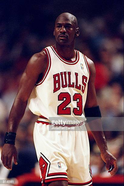 Guard Michael Jordan of the Chicago Bulls looks on during a game against the San Antonio Spurs at the United Center in Chicago Illinois The Bulls won...