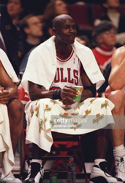 Guard Michael Jordan of the Chicago Bulls sits on the bench during a game against the Philadelphia 76ers at the United Center in Chicago Illinois The...