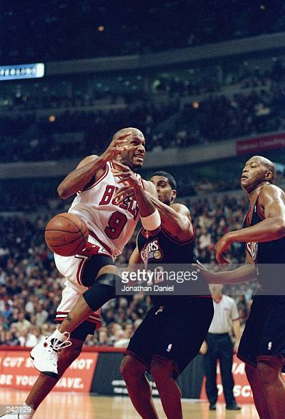 Guard Ron Harper of the Chicago Bulls in action against guard Jim Jackson of the Philadelphia 76ers during a game at the United Center in Chicago...