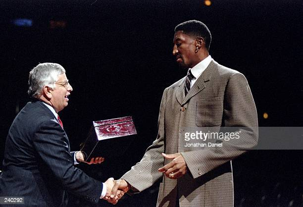 Guard Scottie Pippen of the Chicago Bulls shakes hands with David Stern during the presentation of championship rings prior to a game against the...