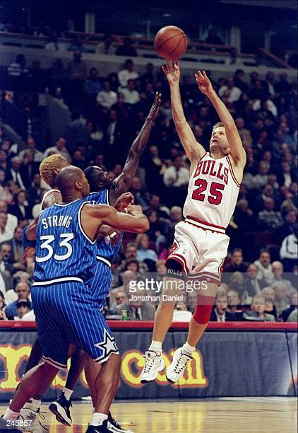 Guard Steve Kerr of the Chicago Bulls shoots the ball over forward Derek Strong of the Orlando Magic during a game at the United Center in Chicago...