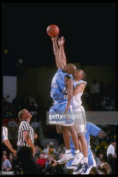 Guard Vince Carter of the North Carolina Tar Heels tries to block a shot during a game against the UCLA Bruins at the Great Alaska Shootout at the...