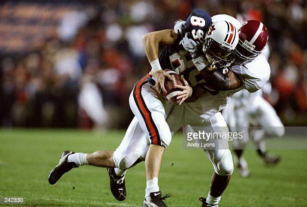 Hicks Poor of the Auburn Tigers tries to get away from free safety Kelvin Sigler of the Alabama Crimson Tide during a game at the JordanHare Stadium...