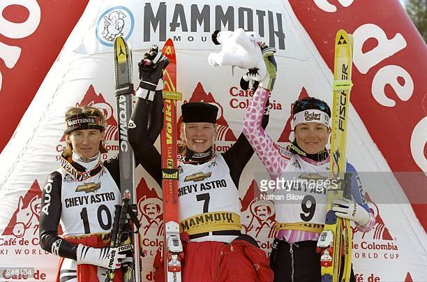 Katharina Gutensohn Katja Seizinger of Germany and Isolde Kostner of Italy wave to the crowd during World Cup Skiing in Mammoth Mountain California...