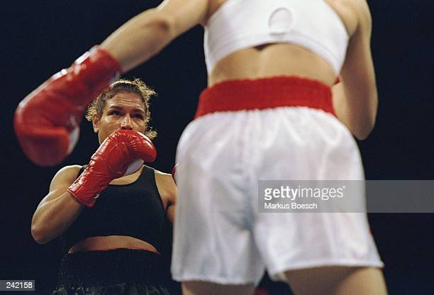 Lucia Rijker trades blows with Jeannette Witte during a fight at the Grand Olympic Auditorium in Los Angeles California Rijker won the bout with a...