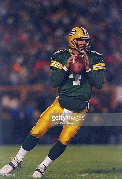 Quarterback Brett Favre of the Green Bay Packers drops back to pass during the Packers 2010 win over the Detroit Lions at Lambeau Field in Green Bay...