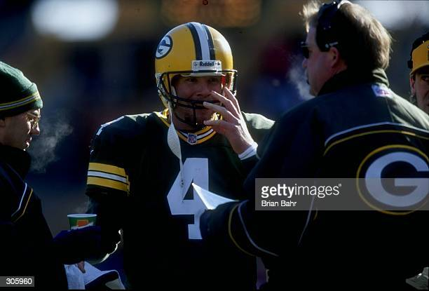 Quarterback Brett Favre of the Green Bay Packers during the Packers 4517 win over the Dallas Cowboys at Lambeau Field in Green Bay Wisconsin...