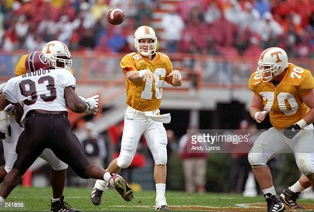 Quarterback Peyton Manning of the Tennessee Volunteers passes the ball during a game against the South Carolina Gamecocks at Neyland Stadium in...