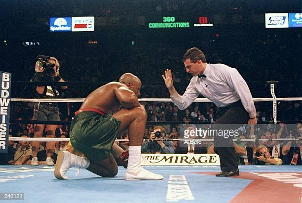 Referee Mitch Halpern counts on Michael Moorer during a fight against Evander Holyfield at the Thomas and Mack Center in Las Vegas Nevada Holyfield...