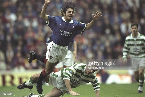 Rino Gattuso of Rangers takes a dive off Tommy Boyd of Celtic's challenge during the Bells Scottish Premiership match at Ibrox in Glasgow Scotland...