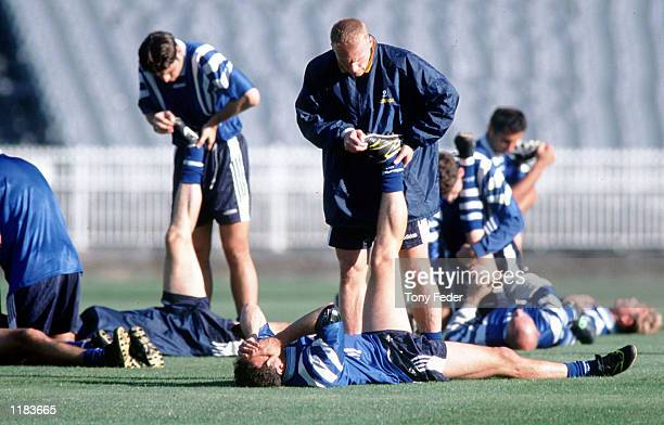 Robbie Slater of the Socceroos warms up with teammate Graham Arnold in preperation for the 2nd leg of the World Cup Qualifier between Australia and...