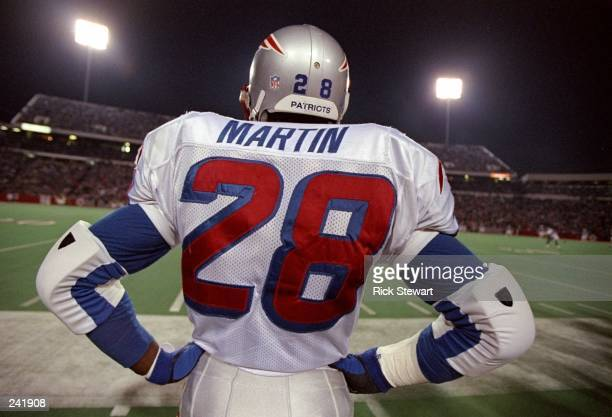 Running back Curtis Martin of the New England Patriots looks on during a game against the Buffalo Bills at Rich Stadium in Orchard Park New York The...