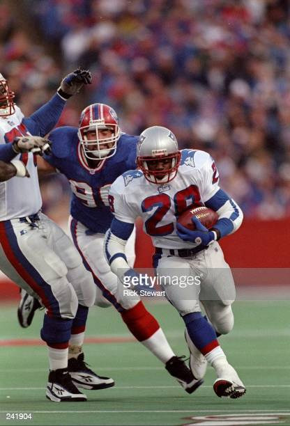 Running back Curtis Martin of the New England Patriots runs with the ball during a game against the Buffalo Bills at Rich Stadium in Orchard Park,...