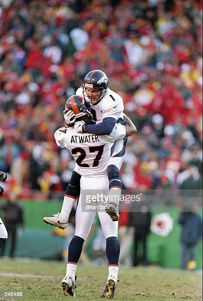 Safety Steve Atwater and kicker Jason Elam of the Denver Broncos celebrate after a field goal during a game against the Kansas City Chiefs at...