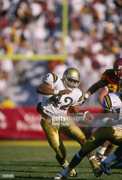 Tailback Skip Hicks of the UCLA Bruins runs with the ball during a game against the USC Trojans at the Los Angeles Memorial Coliseum in Los Angeles...