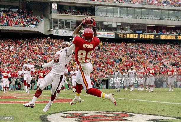 Wide receiver Andre Rison of the Kansas City Chiefs goes up for the ball as cornerback Darnell Walker of the San Francisco 49ers tries to break up...