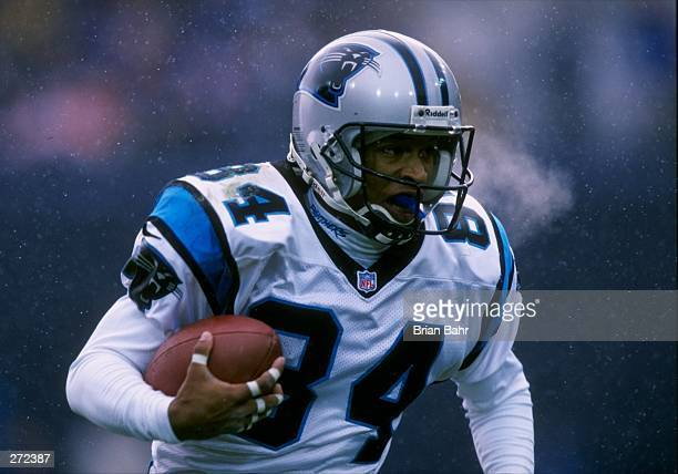 Wide receiver Rae Carruth of the Carolina Panthers moves the ball during a game against the Denver Broncos at Mile High Stadium in Denver, Colorado....