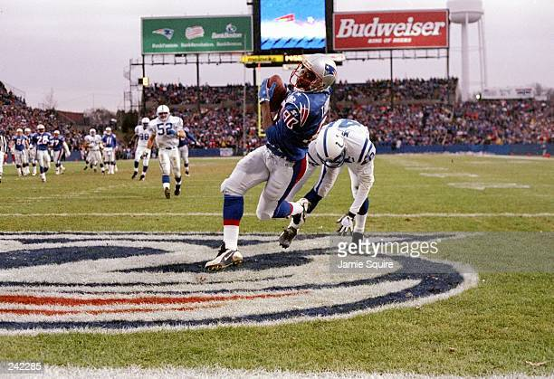 Wide receiver Troy Brown of the New England Patriots makes a catch for a touchdown as defensive back Ray McElroy of the Indianapolis Colts misses a...