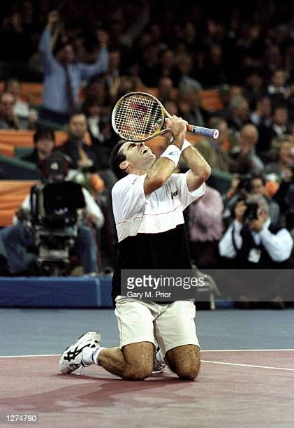 Alex Corretja celebrates his five set win over fellow Spaniard Carlos Moya in the final of the ATP Tour World Championships at the EXPO 2000 Tennis...