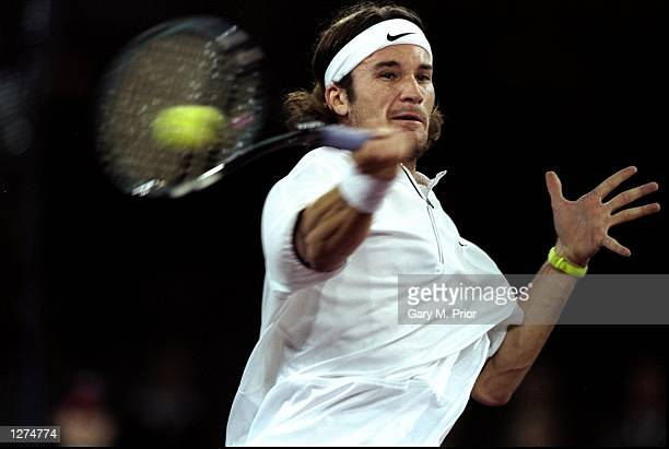 Carlos Moya of Spain powers a forehand during the ATP Tour World Championships at the EXPO 2000 Tennis Dome in Hannover, Germany. \ Mandatory Credit:...