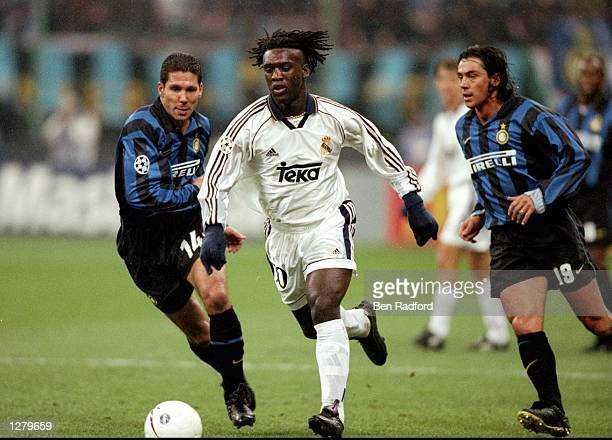 Clarence Seedorf of Real Madrid gets away from Diego Simeone and Paulo Sousa of Inter Milan during the UEFA Champions League match at the San Siro in...