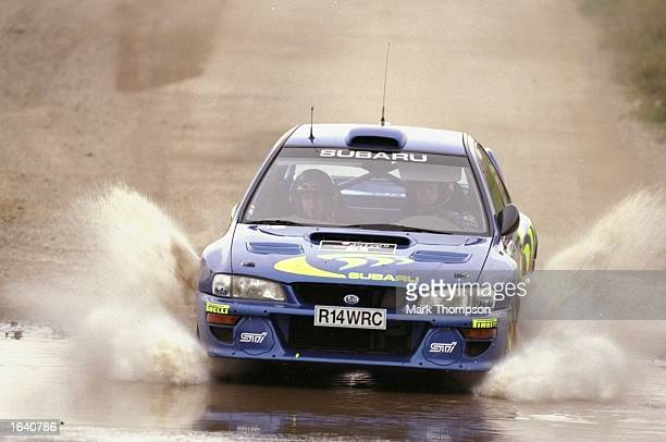 Colin McRae of the Subaru Impreza WRC team in action during the Super Stage 7 of the Network Q Rally of Great Britain at Silverstone in...