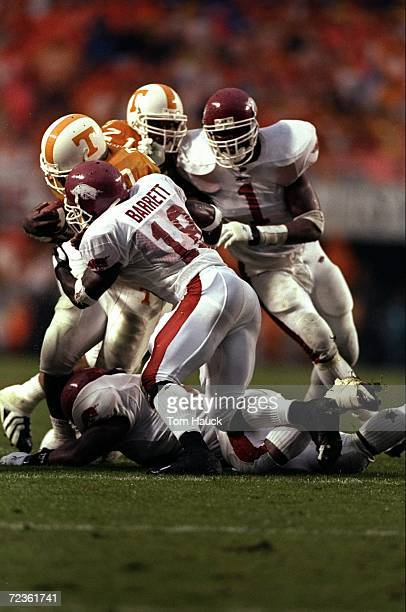 Cornerback David Barrett and back Jim Ed Reed of the Arkansas Razorbacks in action during the game against the Tennessee Volunteers at the Neyland...
