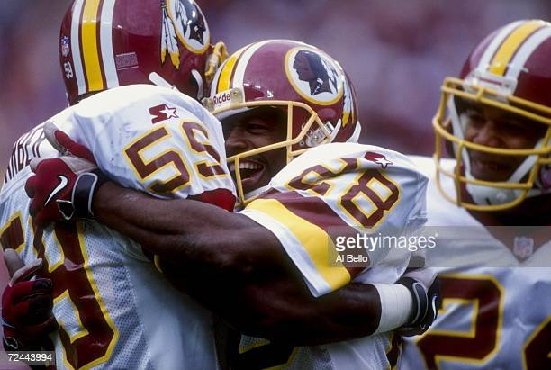 Darrell Green of the Washington Redskins celebrates with teammate Shawn Barber during a game against the New York Giants at Jack Kent Cooke Stadium...