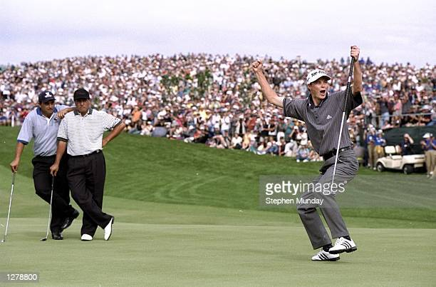 David Carter of England celebrates after winning the World Cup of Golf at the Gulf Harbour Golf Club in Auckland, New Zealand. \ Mandatory Credit:...