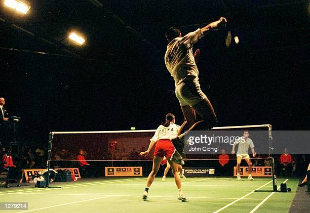 Deng Chuanhai goes of China for a smash during the doubles match against England at the Stevenage Leisure Centre in England. \ Mandatory Credit: John...