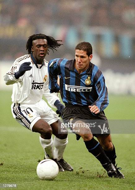 Diego Simeone of Inter Milan loses Clarence Seedorf of Real Madrid during the UEFA Champions League match at the San Siro in Milan Italy Inter won 31...