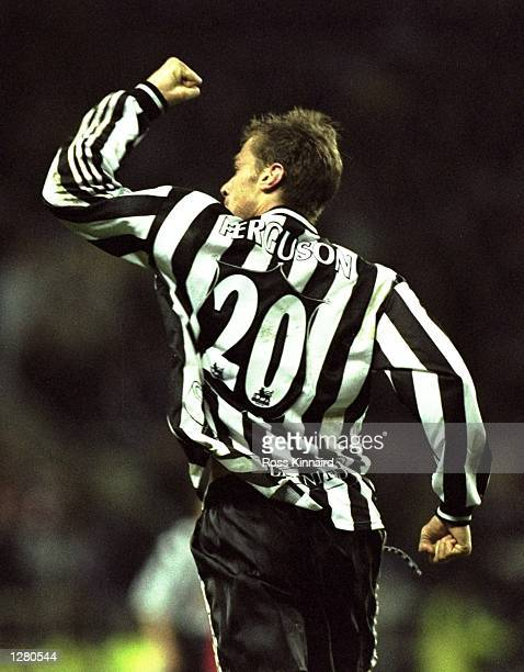 Duncan Ferguson celebrates one of his two goals on his debut for Newcastle United in the FA Carling Premiership match against Wimbledon at St James...