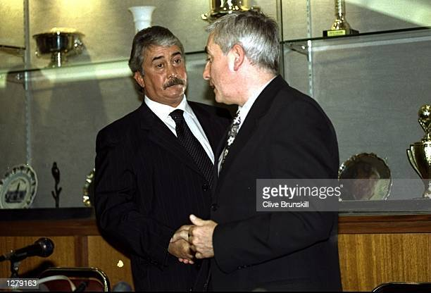 End of an era at Anfield as an emotional Roy Evans shakes hands with Liverpool chairman David Moores on the day he leaves the club after 33 years of...