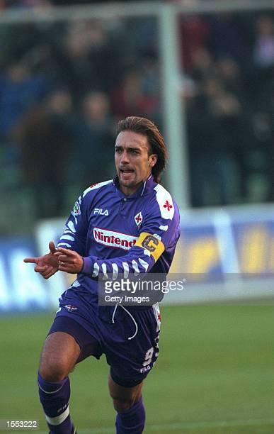 Gabriel Batistuta of Fiorentina runs away to celebrate after scoring a goal during the Serie A match against Inter Milan played in Fiorentina Italy...