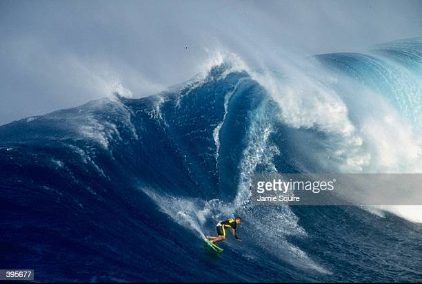 General view of a surfer in action at Ho''Okipa Beach in Maui Hawaii