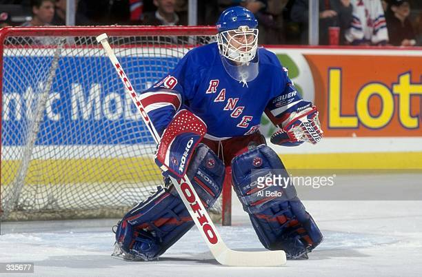 Goallie Dan Cloutier of the New York Rangers in action during the game against the New Jersey Devils at the Continental Ailines Arena in East...