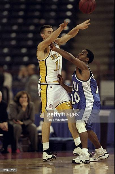 Guard Greg Tonagel of the Valparaiso Crusaders in action against guard Shaheen Holloway of the Seton Hall Pirates during the NABC Classic Game at the...