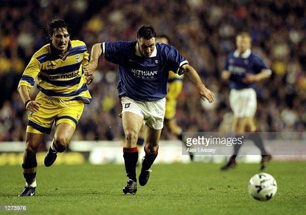 Ian Ferguson of Rangers takes on Dino Baggio of Parma the UEFA Cup third round first leg match at Ibrox Park in Glasgow, Scotland. The game ended...