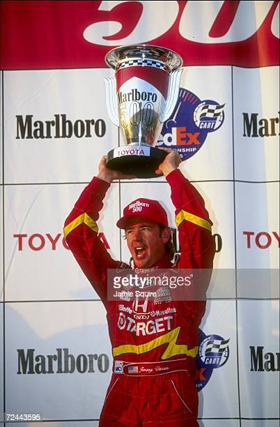 Jimmy Vasser of Team Target/Chip Gnassi and driver of the Reynard Honda 98I holds the trophy following the CART Marlboro 500 at the California...