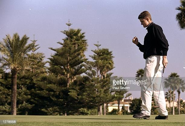 Justin Rose of England sinks a 10 foot putt on the 18th in the fourth round to make the cut of the PGA Tour qualifying school at the San Roque GC in...