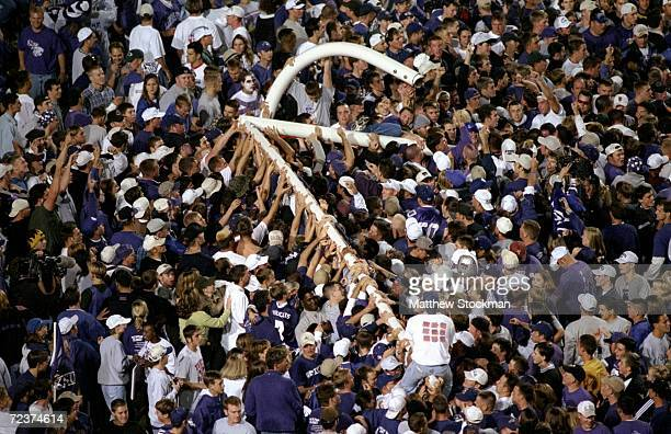 Kansas State Wildcat fans celebrate a victory over the Nebraska Cornhuskers by pulling the goal post down at Wagner Field in Manhattan, Kansas. The...